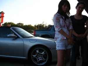 Fast car, Asian girls.  Idyllic scene?